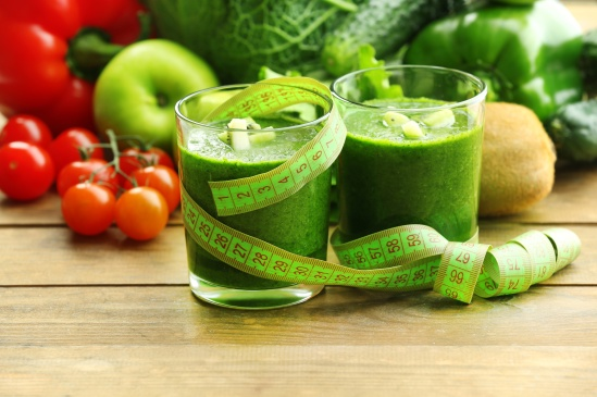 Green fresh healthy juice with fruits and vegetables